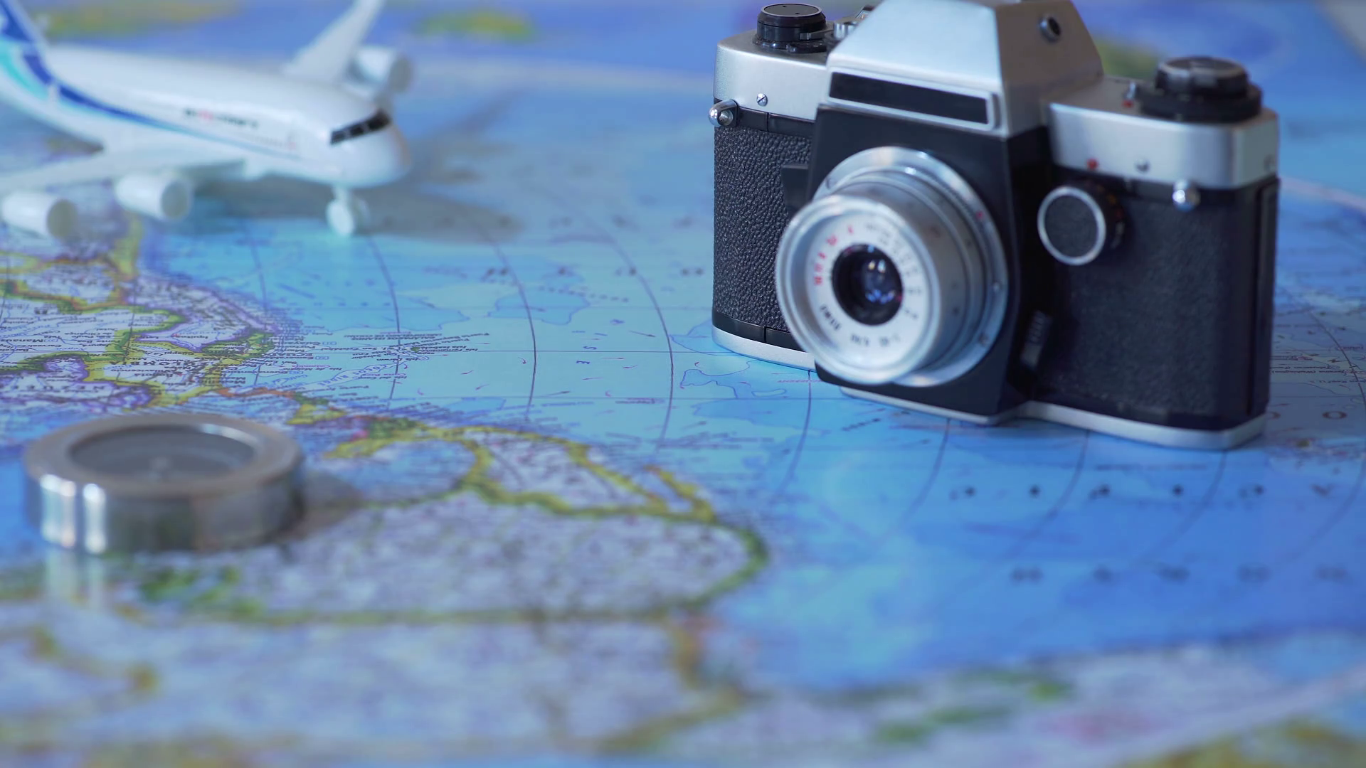 travel accessories and toy plane on world map background vacation planning hsgzbn75ux thumbnail full01 b16cd